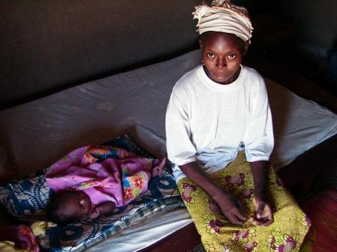 A 17-year-old mother and her newborn daughter in their room in Northern Cameroon