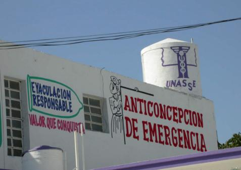 A painted sign on the side of a building in the Henequenera zone of Yucatan, Mexico, advertises emergency contraception.